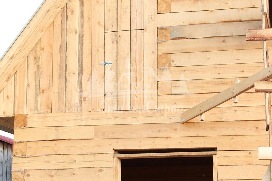 Дом из бруса с гаражом и мансардой