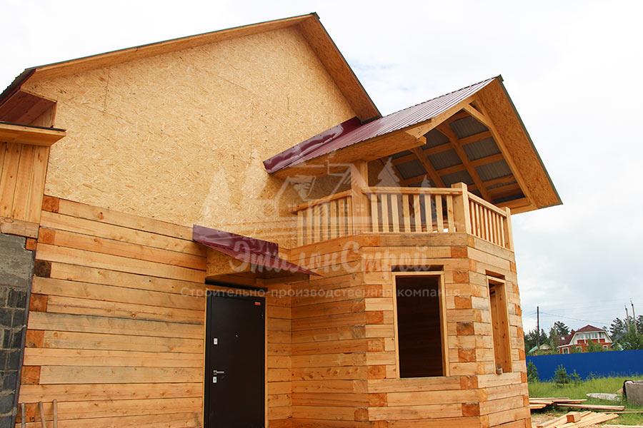 Двухэтажный дом из бруса 144 кв.м с гаражом и балконом